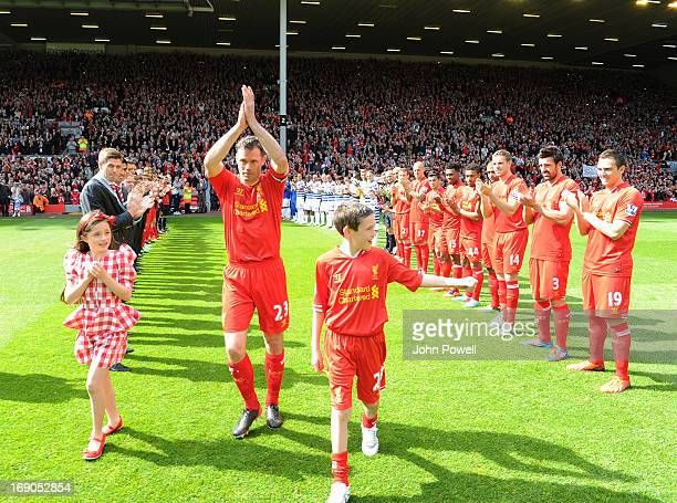 Jamie Carragher of Liverpool is given a guard of honour on his last game for Liverpool FC the Barclays Premier League match between Liverpool and...