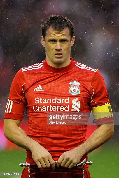 Jamie Carragher of Liverpool looks on prior to the UEFA Europa League playoff first leg match beteween Liverpool and Trabzonspor at Anfield on August...