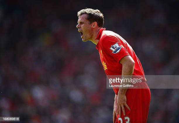 Jamie Carragher of Liverpool shouts to his teammates during the Barclays Premier League match between Liverpool and Everton at Anfield on May 5 2013...