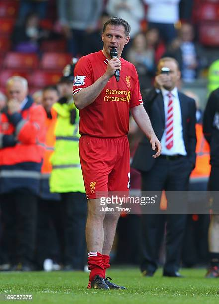 Jamie Carragher of Liverpool speaks to the fans after his last game for the club following the Barclays Premier League match between Liverpool and...