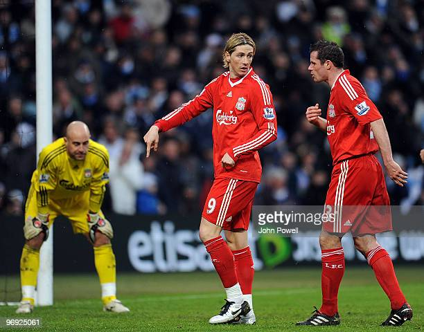 Jamie Carragher of Liverpool talks with Fernando Torres of Liverpool during the Barclays Premier League match between Manchester City and Liverpool...