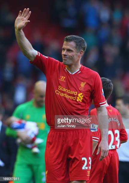Jamie Carragher of Liverpool waves goodbye to the fans after his last game for the club following the Barclays Premier League match between Liverpool...
