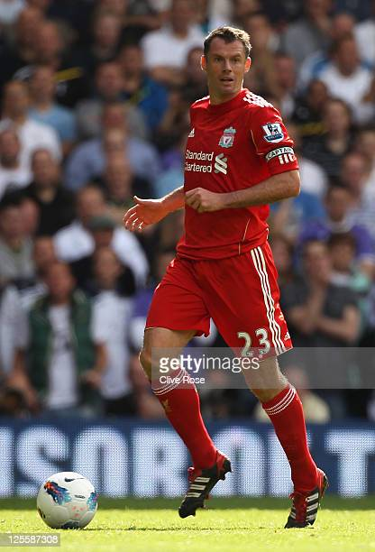 Jamie Carragher of Liverpool with the ball during the Barclays Premier League match between Tottenham Hotspur and Liverpool at White Hart Lane on...