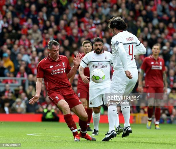 Jamie Carragher of LiverpoolFC Legends with Kakha Kaladze of Milan Glorie during the friendly match between Liverpool FC Legends and AC Milan Glorie...