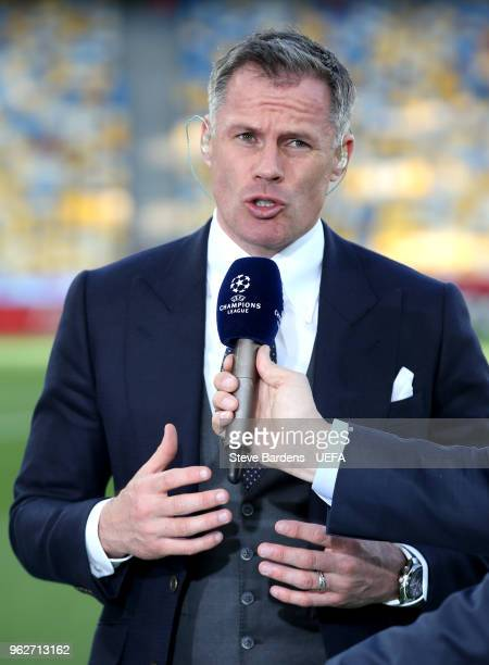 Jamie Carragher speaks to the TV cameras while presenting prior to the UEFA Champions League Final between Real Madrid and Liverpool at NSC...
