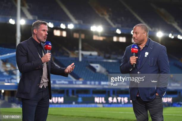 Jamie Carragher speaks with John Barnes for Sky Sports after the Premier League match between Everton FC and Liverpool FC at Goodison Park on June...