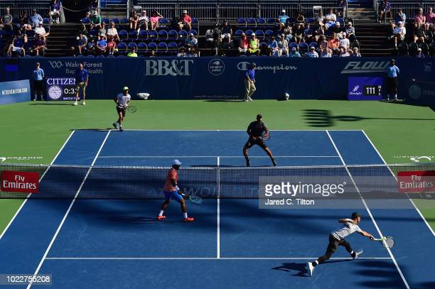 Jamie Cerretani and Leander Paes of India return a shot to JeanJulien Rojer of Netherlands and Horia Tecau of Romania during their match in the men's...