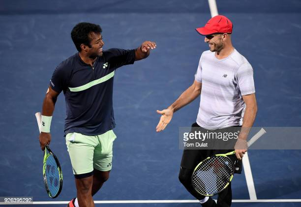 Jamie Cerretani of United States and Leander Paes of India celebrate a point during their semi final match against Damir Dzumhur of Bosnia and...