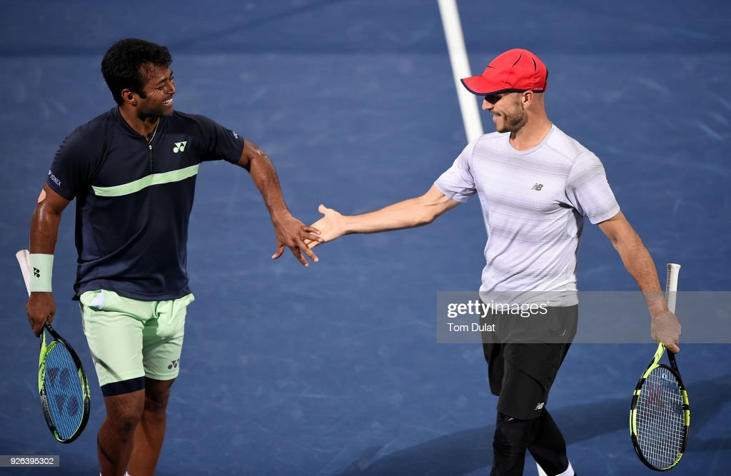 Jamie Cerretani of United States and Leander Paes of India celebrate a point during their semi final match against Damir Dzumhur of Bosnia and Herzegovina and Filip Krajinovic of Serbia on day five of the ATP Dubai Duty Free Tennis Championships at the Dubai Duty Free Stadium on March 2, 2018 in Dubai, United Arab Emirates