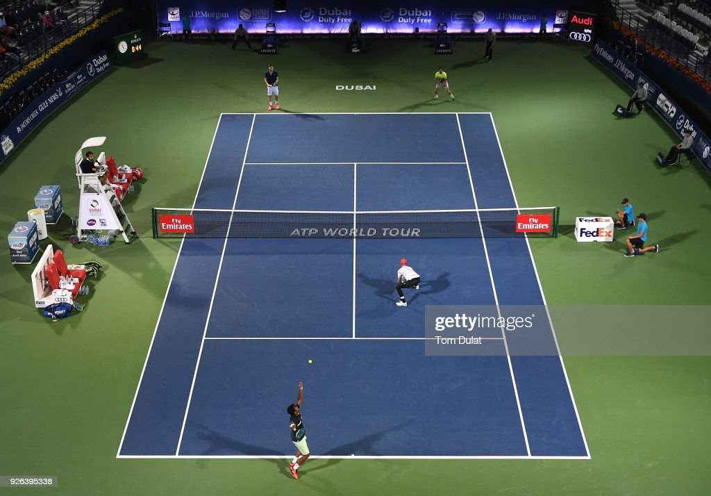 Jamie Cerretani of United States and Leander Paes of India in action during their semi final match against Damir Dzumhur of Bosnia and Herzegovina and Filip Krajinovic of Serbia on day five of the ATP Dubai Duty Free Tennis Championships at the Dubai Duty Free Stadium on March 2, 2018 in Dubai, United Arab Emirates
