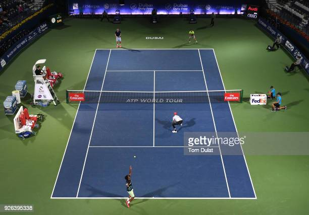 Jamie Cerretani of United States and Leander Paes of India in action during their semi final match against Damir Dzumhur of Bosnia and Herzegovina...