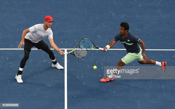 Jamie Cerretani of United States and Leander Paes of India in action during their doubles final match against JeanJulien Rojer of Netherlands and...