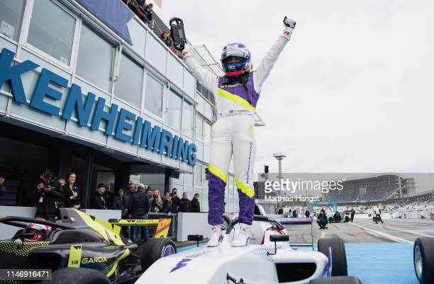 Jamie Chadwick of Great Britain celebrates after winning the first race of the W Series at Hockenheimring on May 04, 2019 in Hockenheim, Germany. W...