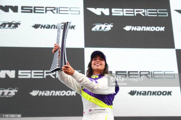 Jamie Chadwick of Great Britain celebrates on the podium after winning the inaugural W Series Championship at Brands Hatch on August 11, 2019 in...