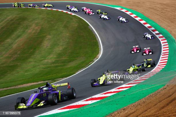 Jamie Chadwick of Great Britain drives her a Tatuus F3 T-318 as she leads the field in to the first corners during the W Series round six and final...