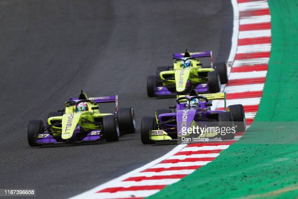Jamie Chadwick of Great Britain drives her a Tatuus F3 T-318 next to Alice Powell of Great Britain and Emma Kimilainen of Finland as she leads the...