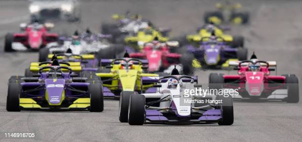 Jamie Chadwick of Great Britain leads the field during first race of the W Series at Hockenheimring on May 04, 2019 in Hockenheim, Germany. W Series...