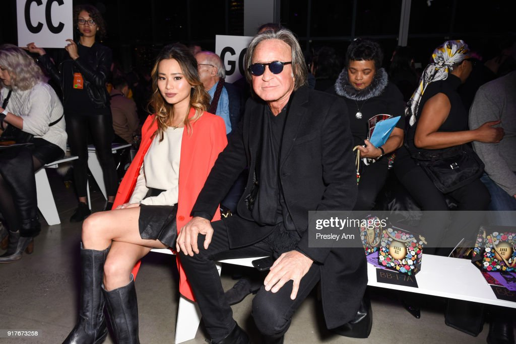 Jamie Chung and Mohamed Hadid attend Anna Sui - Front Row - February 2018 - New York Fashion Week: at Spring Studios on February 12, 2018 in New York City.