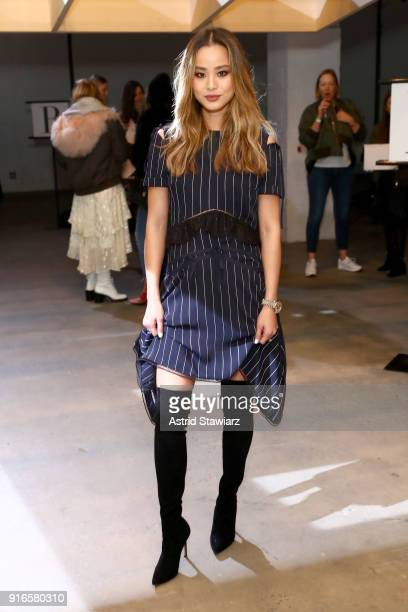 Jamie Chung attends the SelfPortrait Fall Winter 2018 Front Row New York Fashion Week at SIR Stage37 on February 10 2018 in New York City