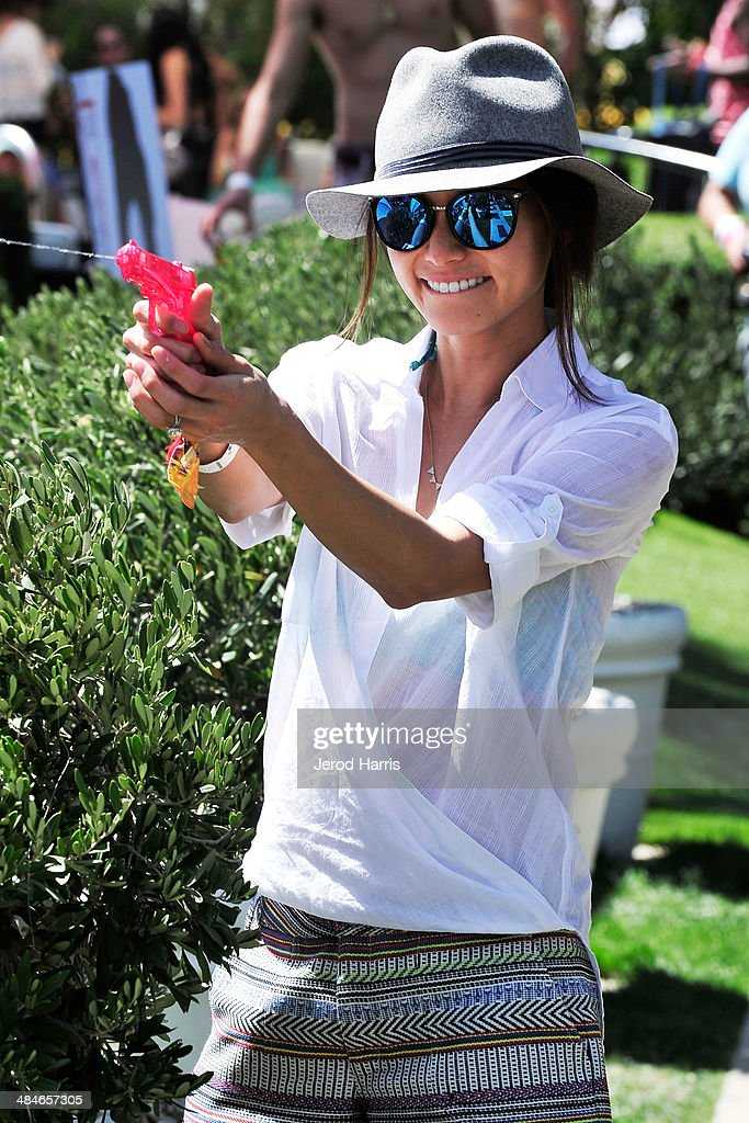 Jamie Chung gets in a squirt gun fight at the GUESS Hotel at the Viceroy Palm Springs on April 13, 2014 in Palm Springs, California.
