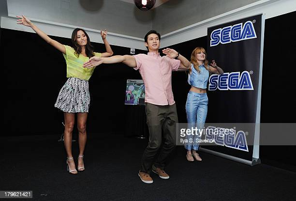 Jamie Chung Harry Shum Jr and Bella Thorne dance during Sega GO DANCE mobile game unveil party at STK Midtown on September 5 2013 in New York City