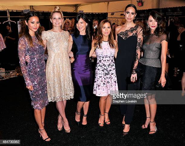 Jamie Chung Jennifer Morrison Perrey Reeves Monique Lhuillier Louise Roe and Abigail Spencer pose backstage at the Monique Lhuillier fashion show...