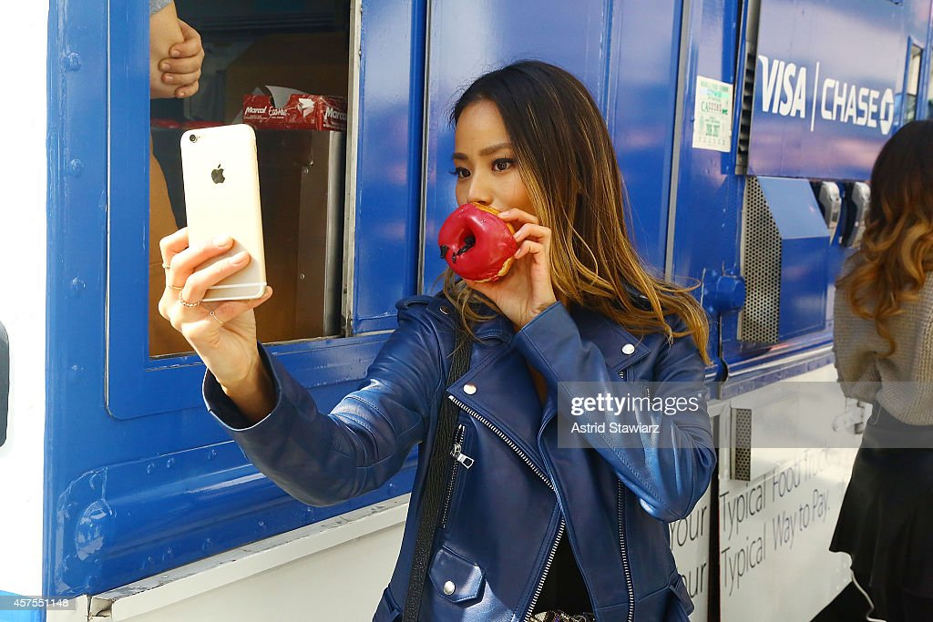 Jamie Chung teams up with Visa and Chase to celebrate the launch of Apple Pay with free doughnuts for all New Yorkers from Dough on October 20, 2014 in New York City.