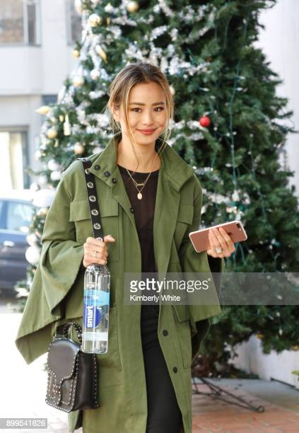 Jamie Chung walks along streets on December 28 2017 in San Francisco California