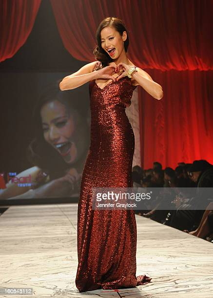 Jamie Chung wearing David Meister Signature on the runway during The Heart Truth 2013 Fashion Show held at the Hammerstein Ballroom on February 6...