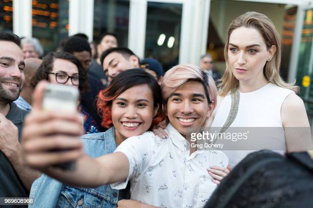 Jamie Clayton takes a selfie with a fan at Netflix's Sense8 Series Finale Fan Screening at ArcLight Hollywood on June 7 2018 in Hollywood California