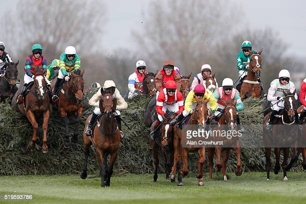 Jamie Codd riding On The Fringe clear 'The Chair' to win The Crabbie's Fox Hunters' Steeple Chase at Aintree Racecourse on April 7 2016 in Liverpool...