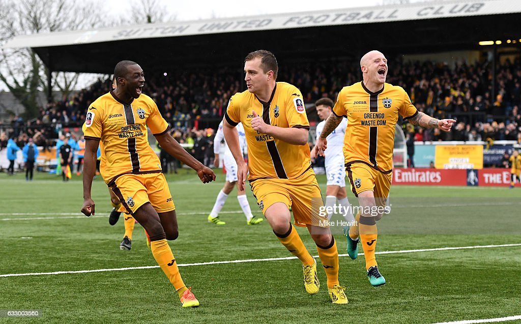 Jamie Collins of Sutton United (C) celebrates scoring his sides first goal with his Sutton United team mates during The Emirates FA Cup Fourth Round match between Sutton United and Leeds United at Borough Sports Ground on January 29, 2017 in Sutton, Greater London.