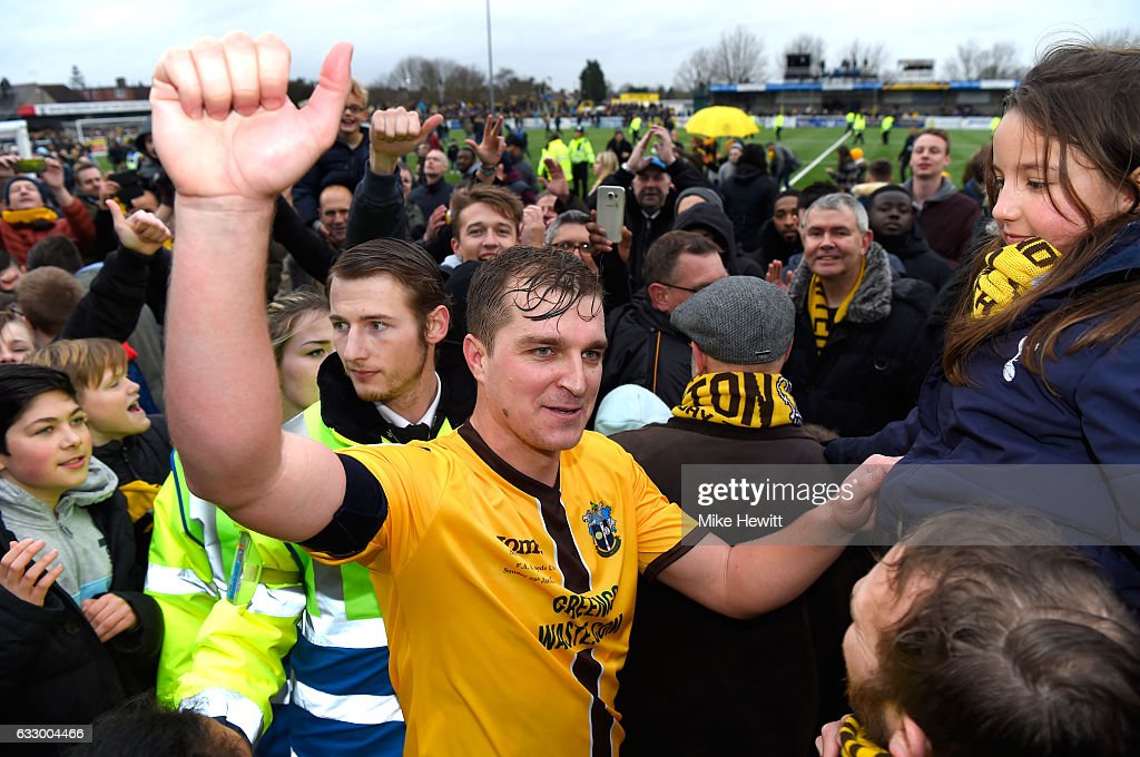 Jamie Collins of Sutton United celebrates with the Sutton United fans after the Emirates FA Cup Fourth Round match between Sutton United and Leeds United at Borough Sports Ground on January 29, 2017 in Sutton, Greater London.