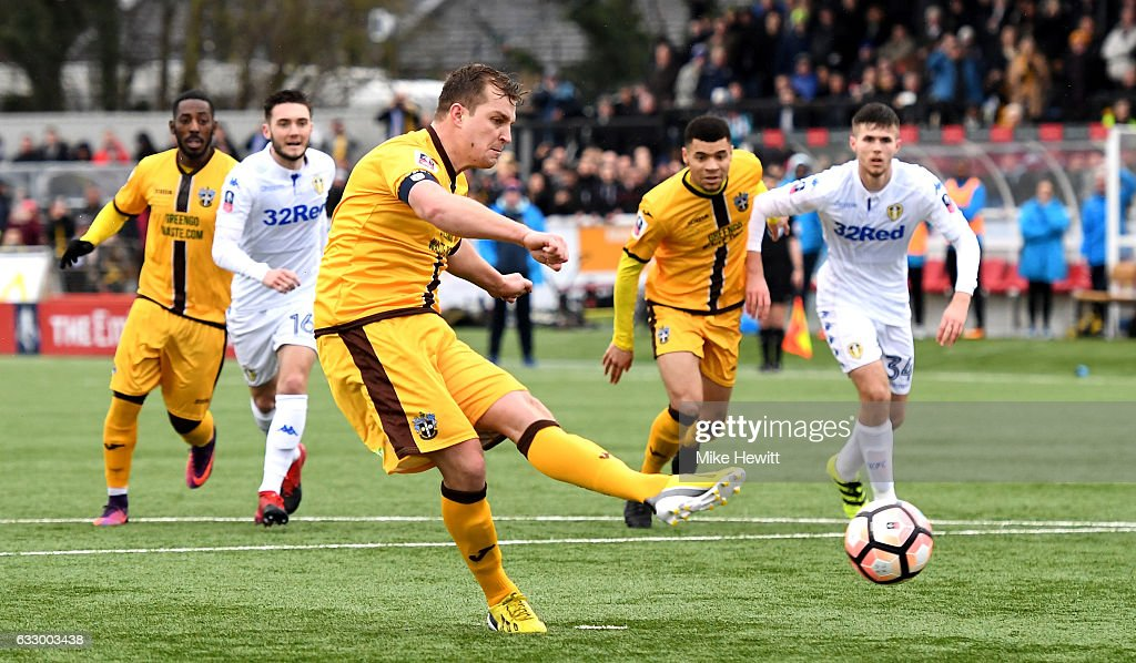 Jamie Collins of Sutton United (C) scores his sides first goal from the penalty spot during The Emirates FA Cup Fourth Round match between Sutton United and Leeds United at Borough Sports Ground on January 29, 2017 in Sutton, Greater London.