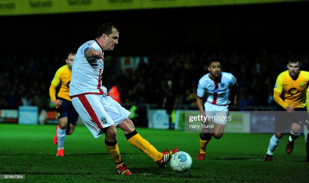 Jamie Collins of Sutton United(C) scores his sides third and winning goal during the Vanarama National League match between Torquay United and Sutton United at Plainmoor on February 20, 2018 in Torquay, England.