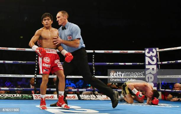 Jamie Conlan is knocked to the floor by Jerwin Ancajas during their IBF SuperFlyweight World Championship title fight on the Frampton Reborn boxing...