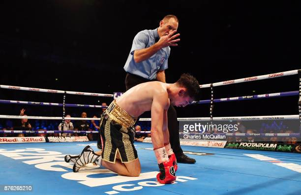 Jamie Conlan is knocked to the floor by Jerwin Ancajas for a fourth time during their IBF SuperFlyweight World Championship title fight on the...