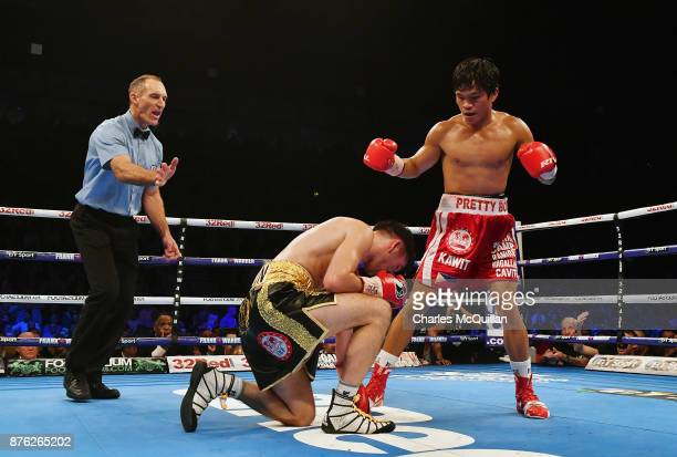 Jamie Conlan is knocked to the floor by Jerwin Ancajas for a third time during their IBF SuperFlyweight World Championship title fight on the...
