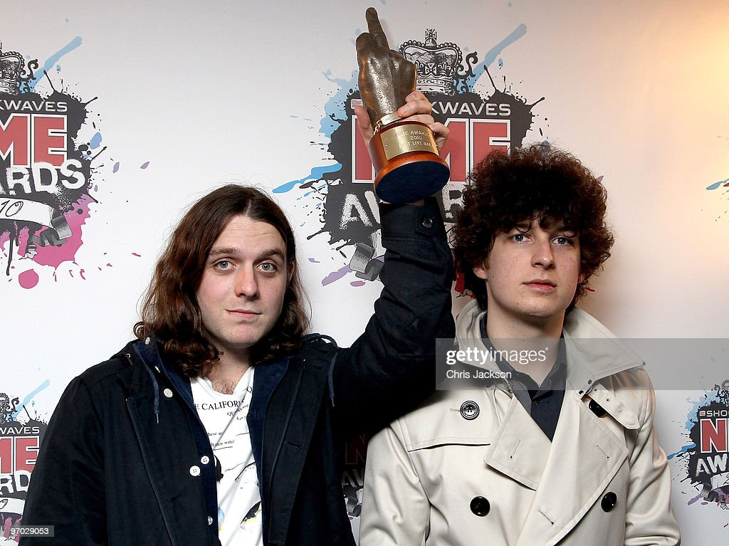 Jamie Cook and Nick O'Malley of the Arctic Monkeys pose with their Award for Best Live Band in the Awards Room at the Shockwaves NME Awards 2010 at Brixton Academy on February 24, 2010 in London, England.