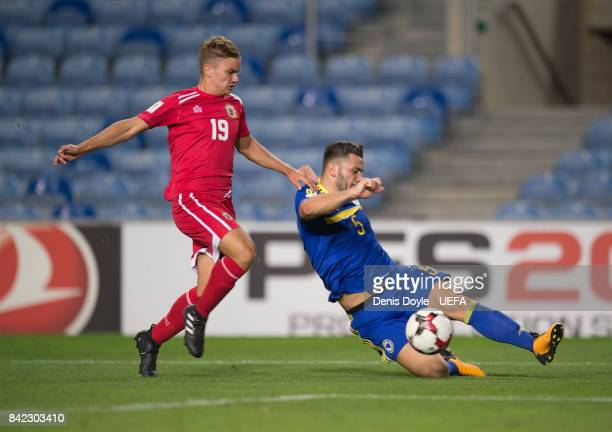 Jamie Coombes of Gibraltar tackles Sead Kolasinac of Bosnia and Herzegovina during FIFA 2018 World Cup Qualifier between Gibraltar and Bosnia and...