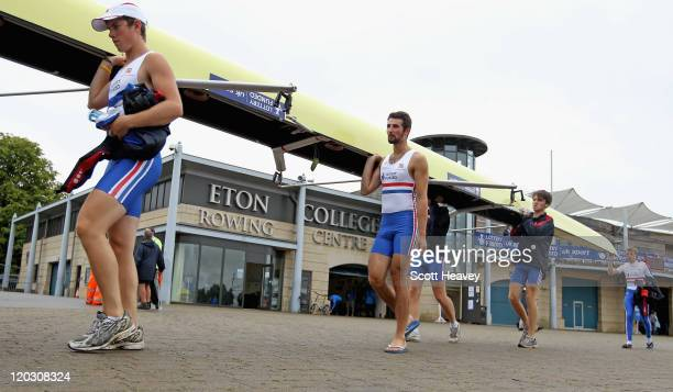 Jamie Copus and Eduardo Munno of Great Britain return their boat after winning the Junior Men's Eight Heat 1 on Day 2 of the FISA 2011 World Rowing...