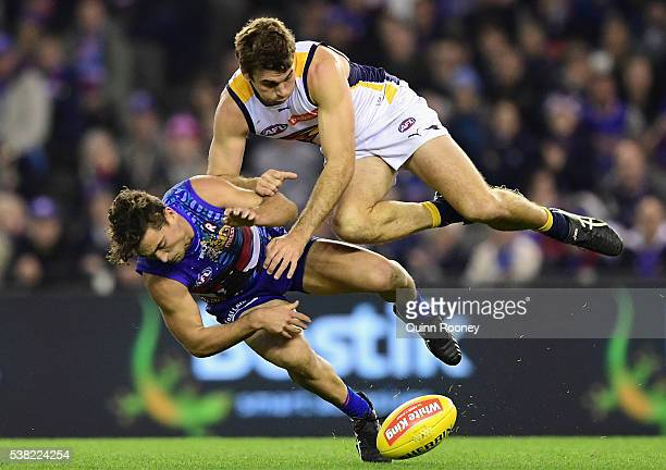 Jamie Cripps of the Eagles bumps Luke Dahlhaus of the Bulldogs during the round 11 AFL match between the Western Bulldogs and the West Coast Eagles...
