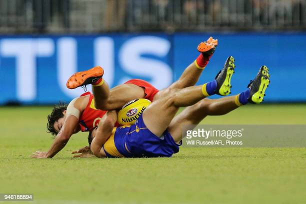 Jamie Cripps of the Eagles is tackled by Jack Bowes of the Suns during the round four AFL match between the West Coast Eagles and the Gold Coast Suns...