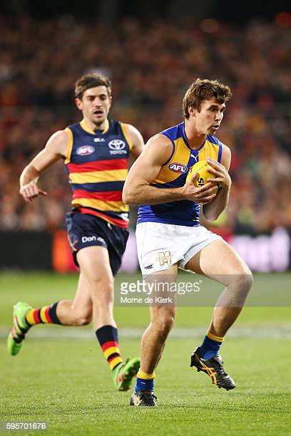 Jamie Cripps of the Eagles takes a mark in front of Ricky Henderson of the Crows during the round 23 AFL match between the Adelaide Crows and the...