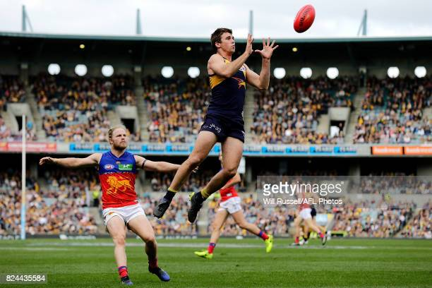 Jamie Cripps of the Eagles takes an overhead mark during the round 19 AFL match between the West Coast Eagles and the Brisbane Lions at Domain...
