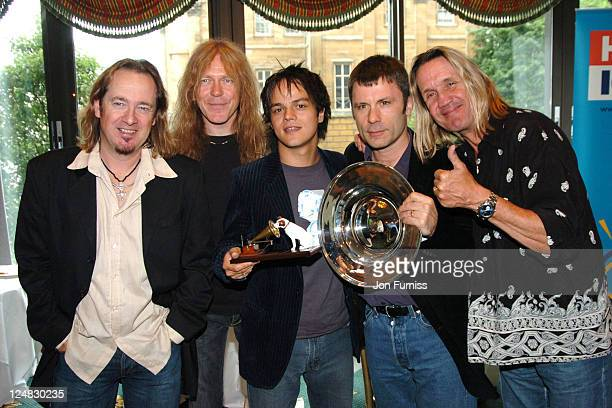 Jamie Cullum winner of the Best New Music Award with Adrian Smith Janick Gers Bruce Dickinson and Nicko McBrain of Iron Maiden