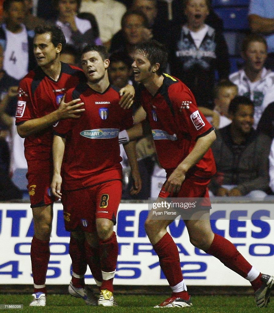 Jamie Cureton (C) of Colchester celebrates with team mates after scoring his teams first goal during the Coca Cola Championship match between Luton Town and Colchester United at Kenilworth Road on September 12, 2006 in Luton, England.