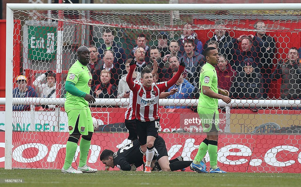 Jamie Cureton of Exeter City celebrates after a cross by team mate Craig Woodman was dropped by Northampton Town goalkeeper Lee Nicholls for Exeter's 1st goal during the npower League Two match between Exeter City and Northampton Town at St James's Park on March 2, 2013 in Exeter, England.
