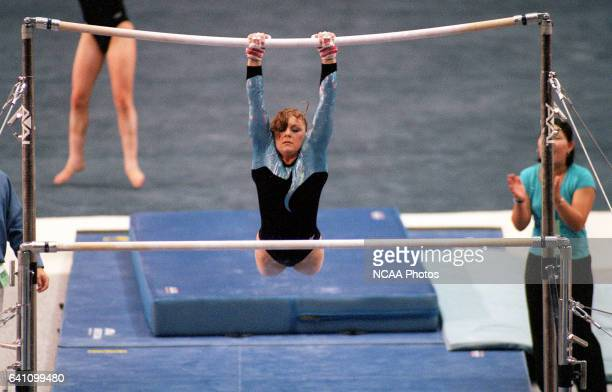 Jamie Dantzscher of UCLA scores a 9975 on the uneven parallel bars to take first place during the Division 1 Women's Gymnastics Championship held at...