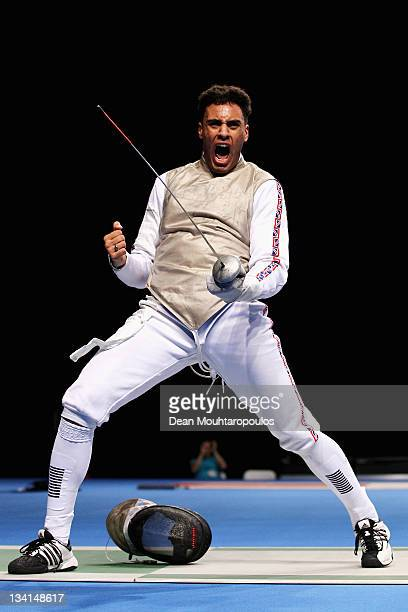 Jamie Davis of Great Britain celebrates his victory over Tommaso Lari of Italy during the Men's Foil Team Event at the Fencing Invitational part of...